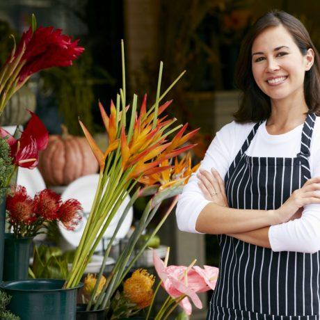 42256863 - portrait of female florist outside shop